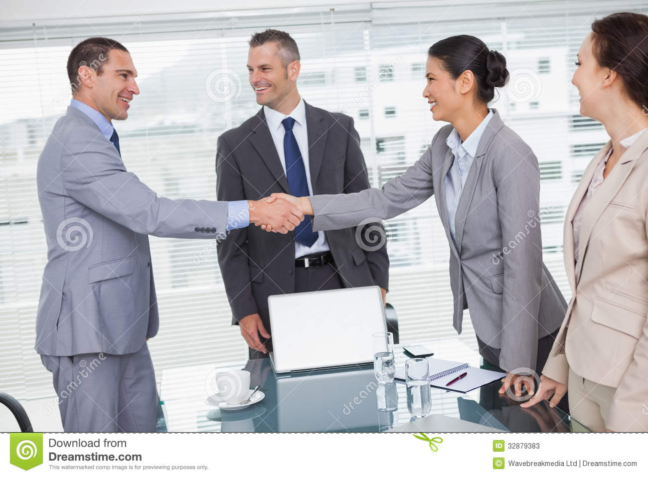 Cheerful Business People Meeting And Shaking Hands Stock Image