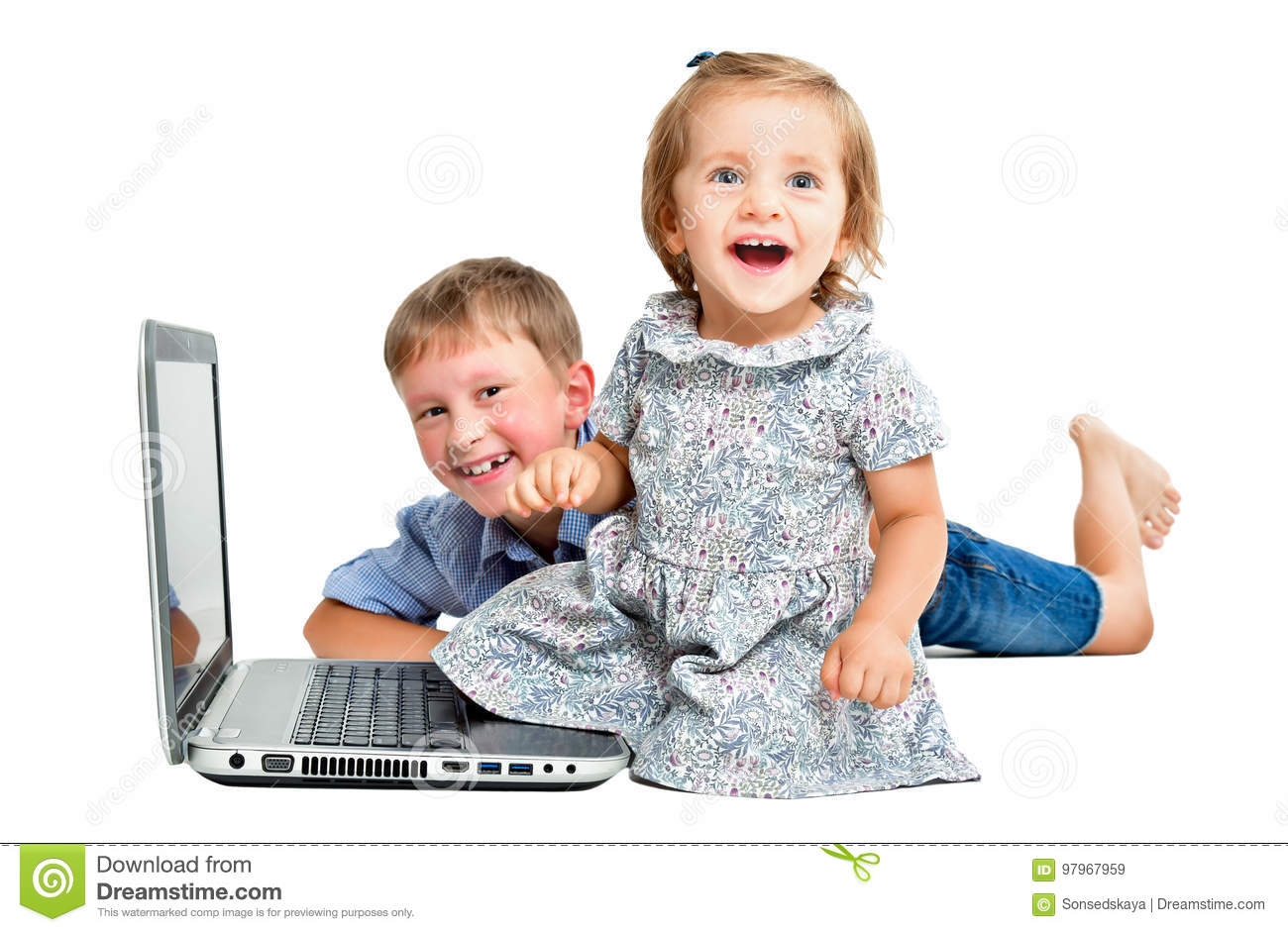 Cheerful children, sitting in front of laptop