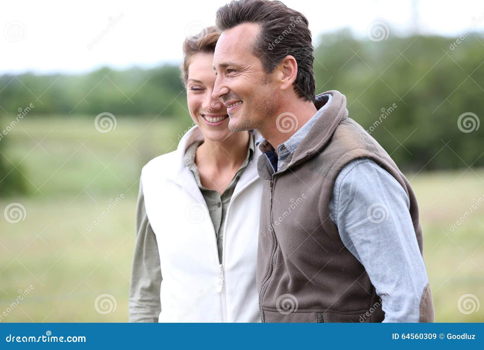 Cheerful couple on countryside walking