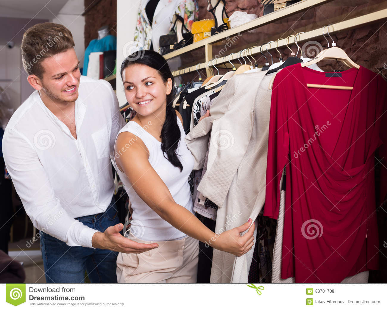 Cheerful Couple Purchasing Dress And Blouse Stock Photo