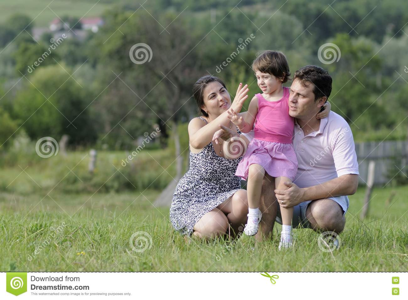 Cheerful family relaxing in nature royalty free stock for Cheerful nature