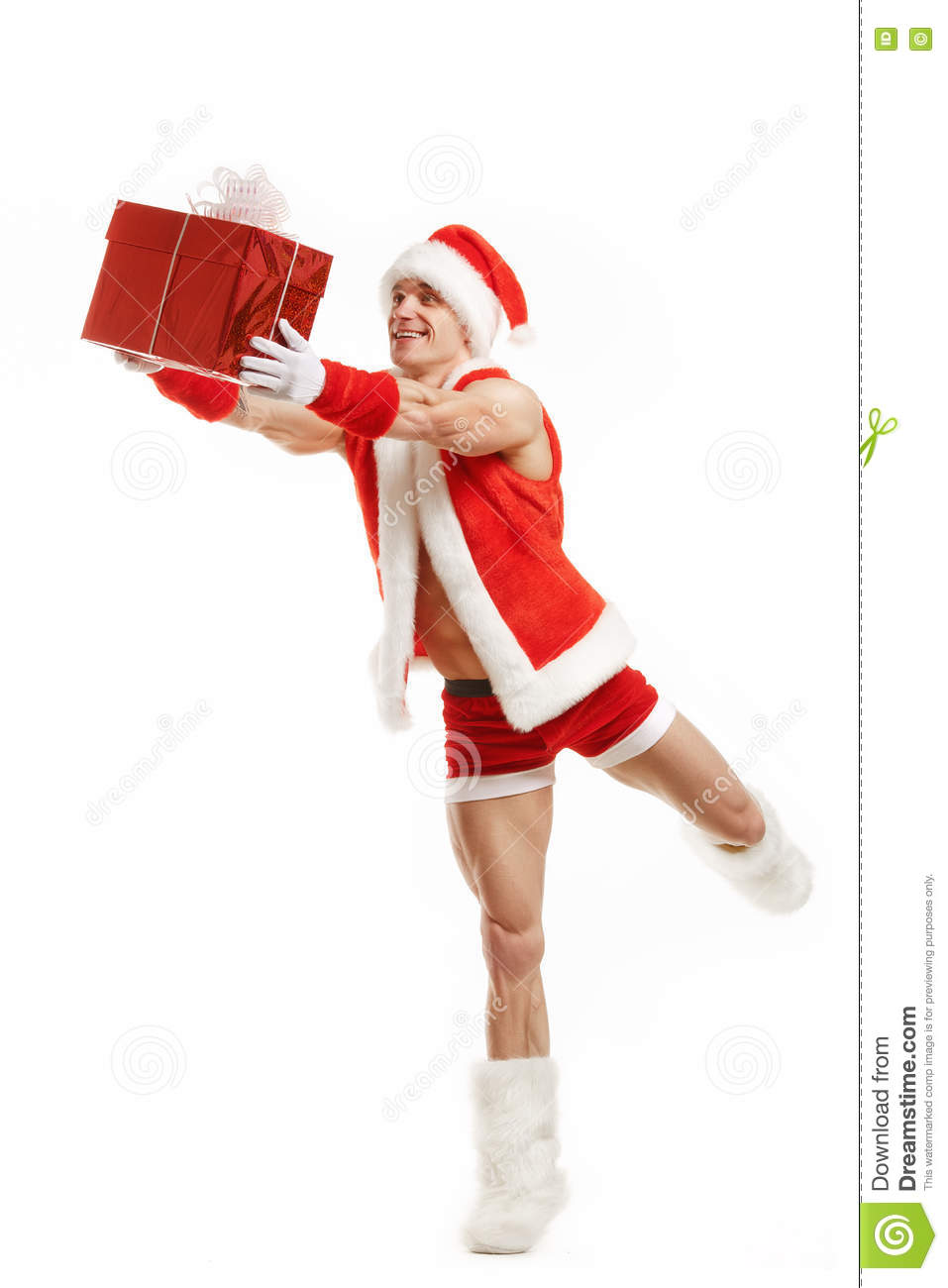 Cheerful fitness Santa Claus holding a red box