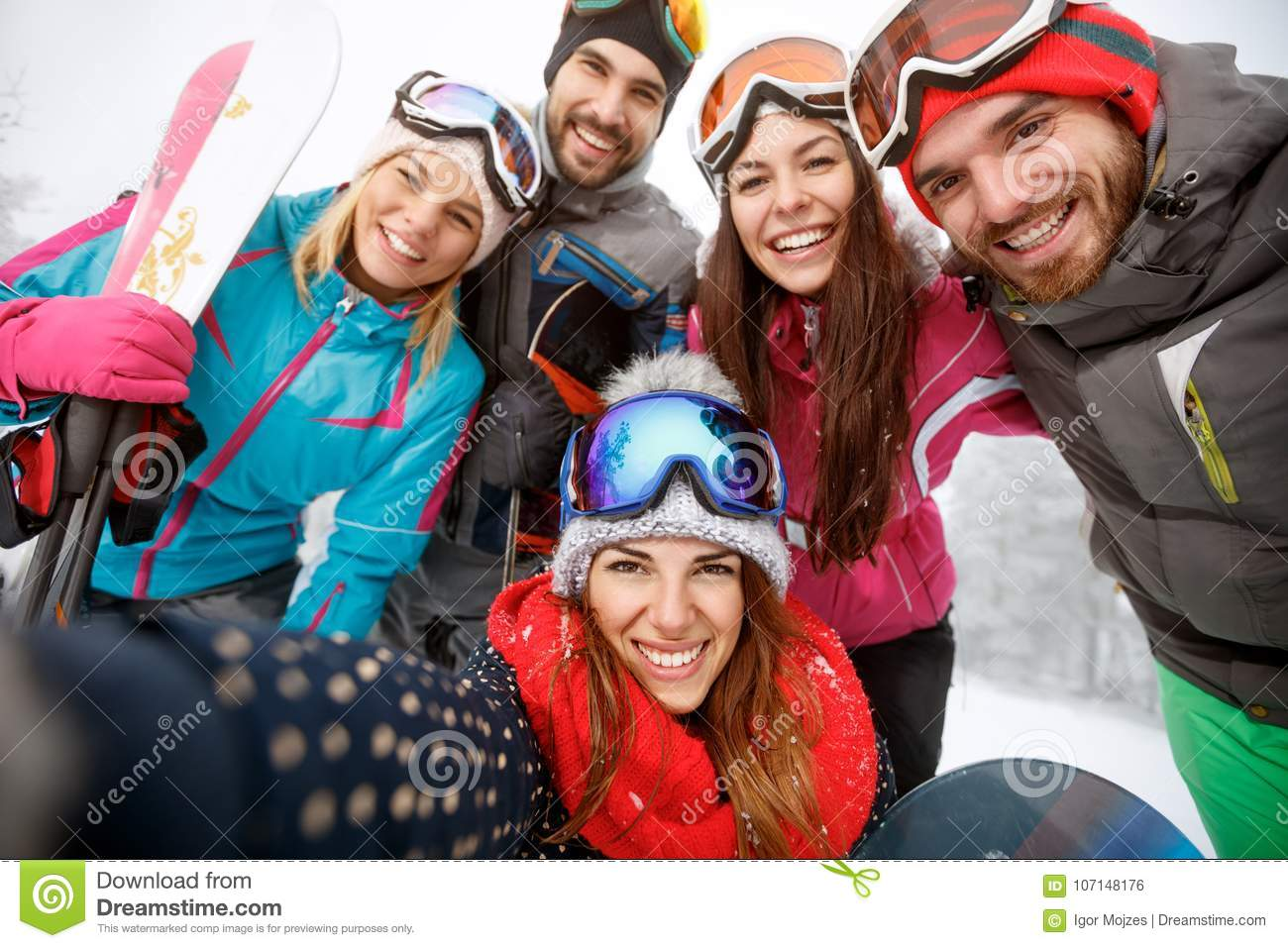 Cheerful friends at skiing