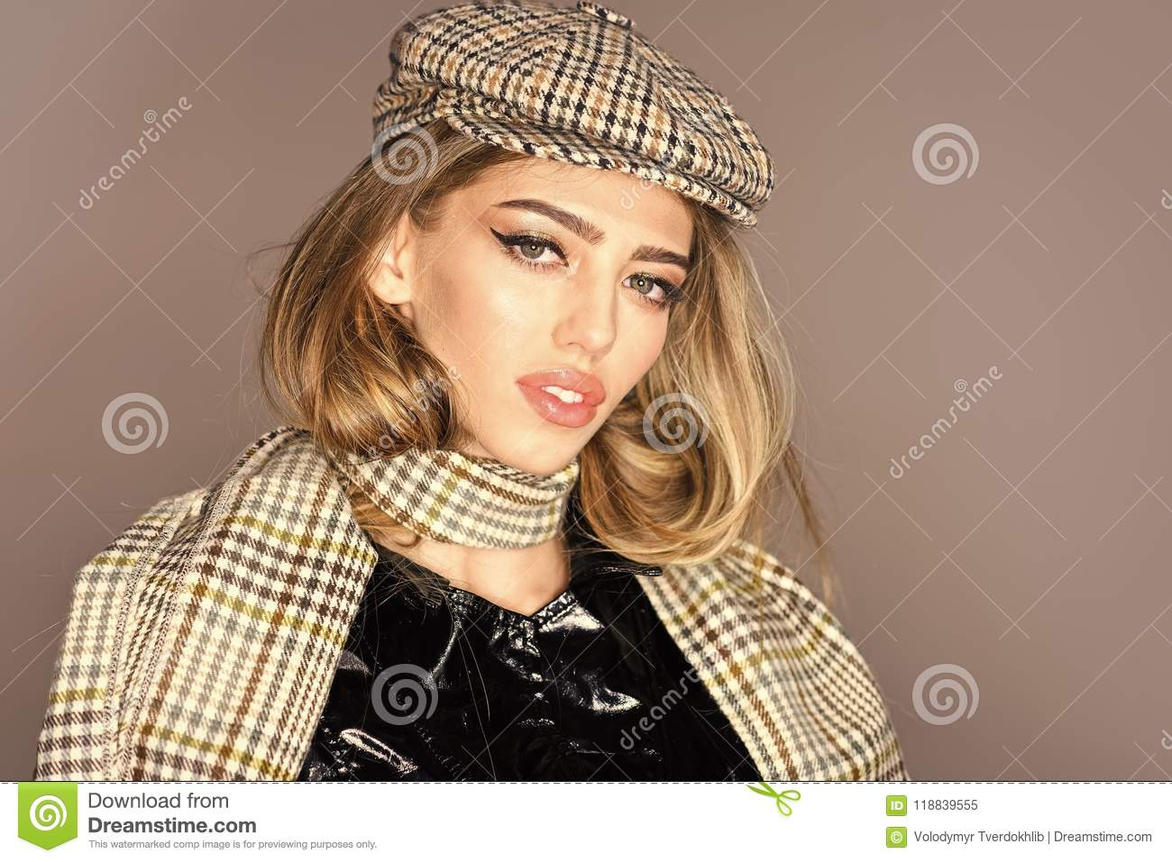 047b1ea781b Cheerful girl in autumn clothes. Woman on calm face with make up with  checkered accessories. Girl with long hair wears plaid kepi