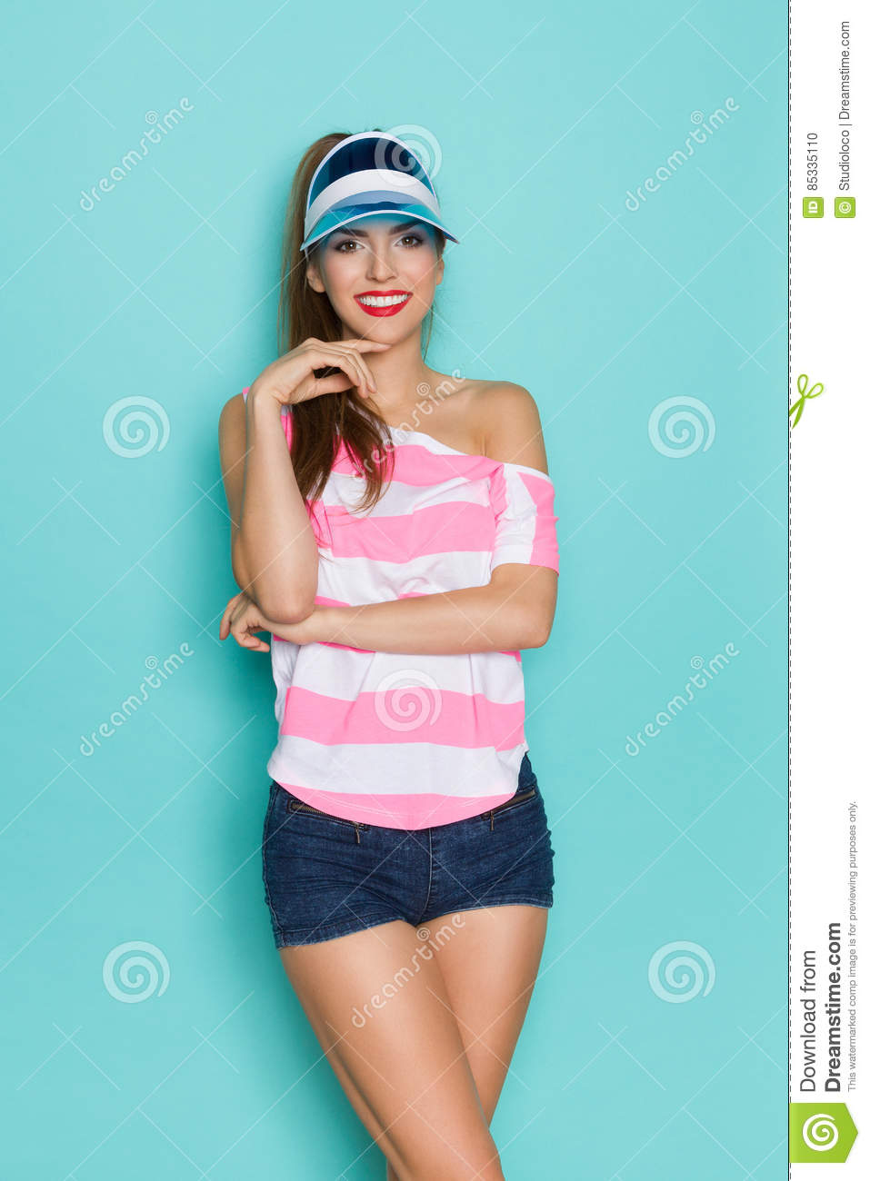 490db7d48adfe5 Cheerful Girl In Pink Stripd Shirt And Jeans Shorts Stock Photo ...