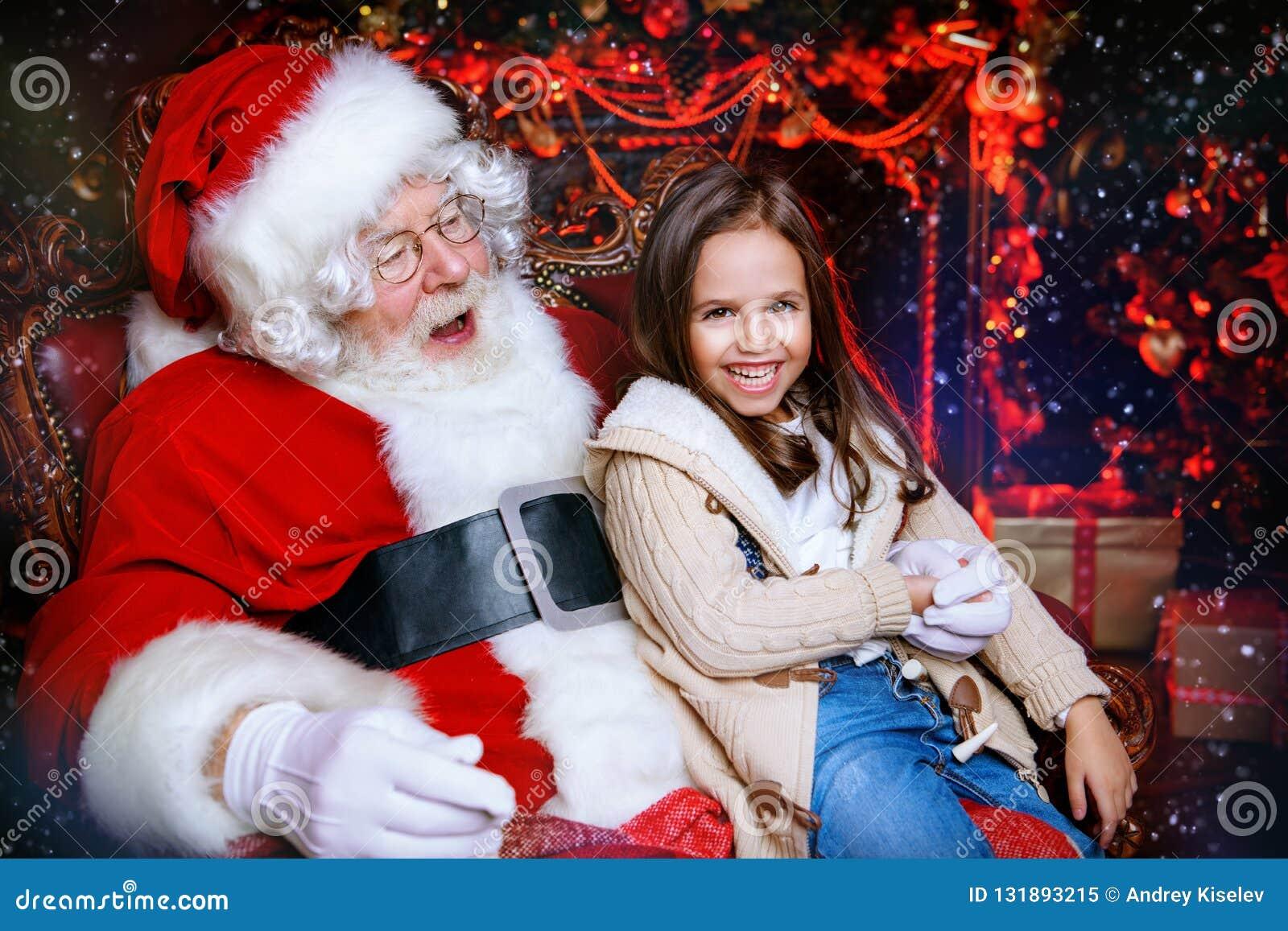 Cheerful girl with santa