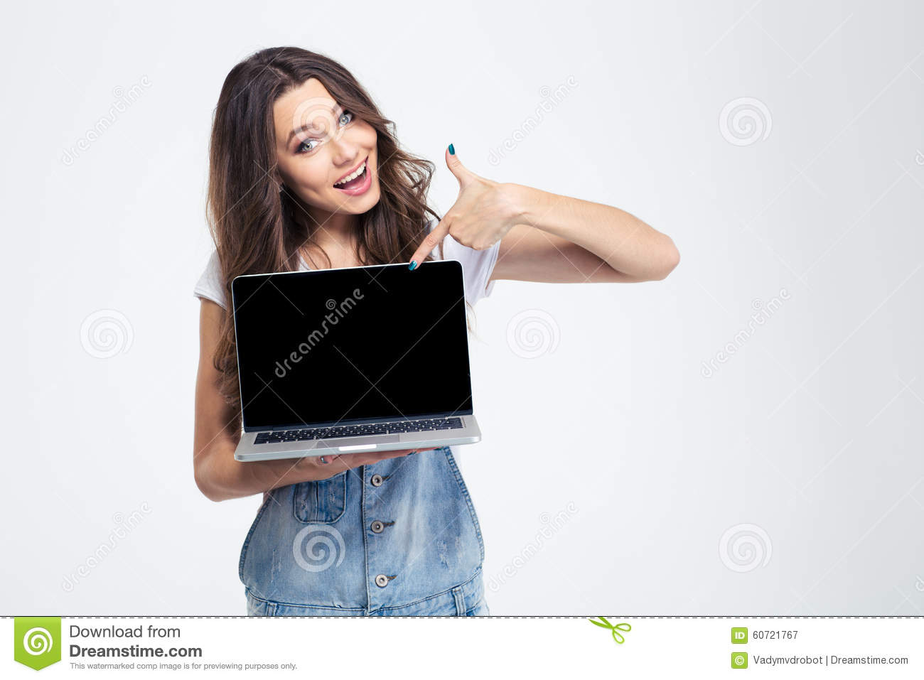 Cheerful girl showing blank laptop computer screen