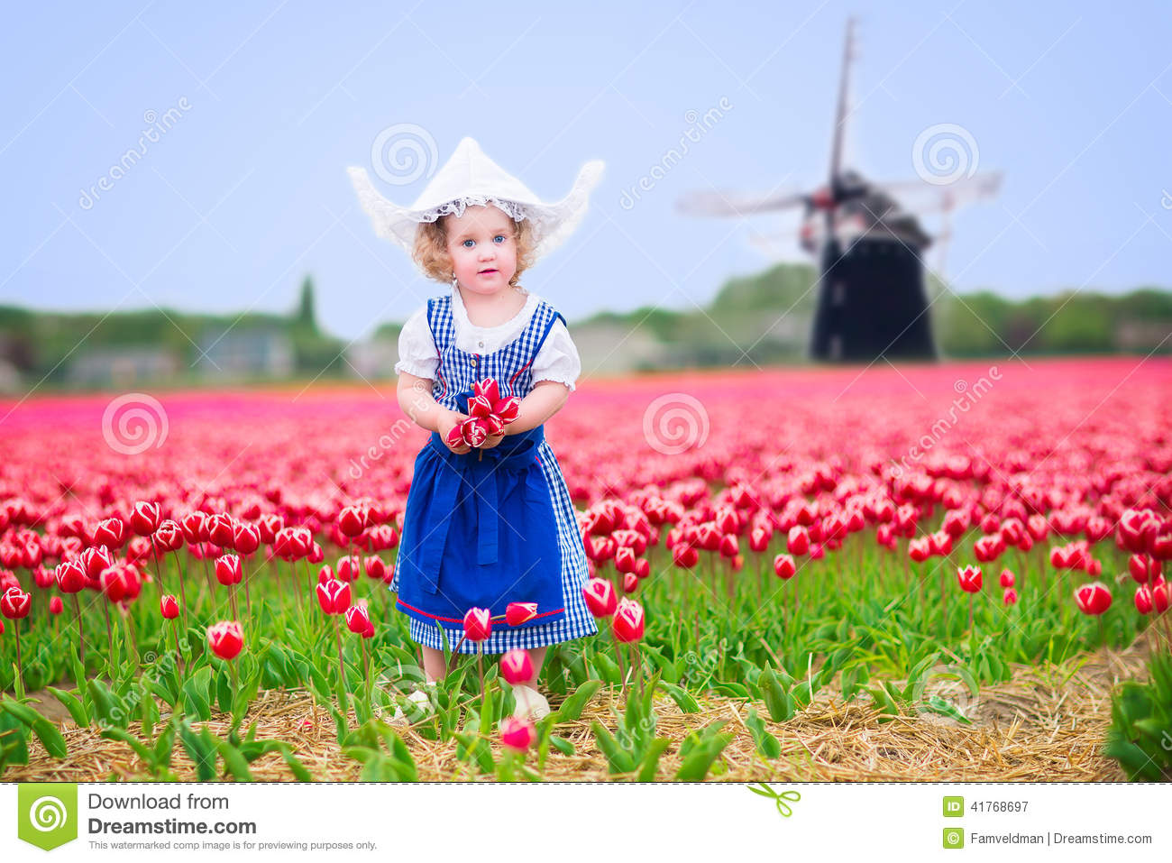 Cheerful Girl In Tulips Field With Windmill In Dutch ...