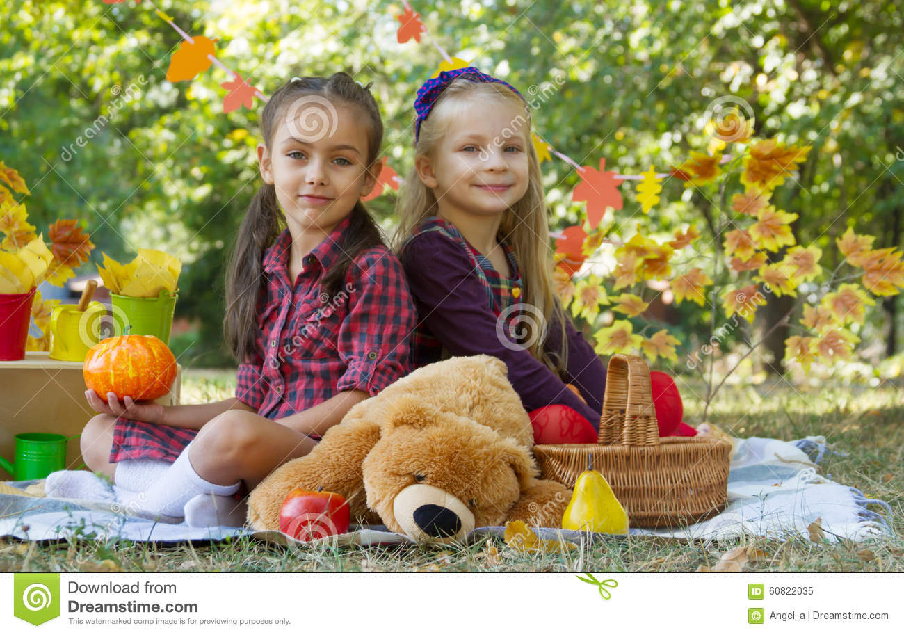 Cheerful Girls Having Fun On Autumn Picnic In Park Stock Photo ...
