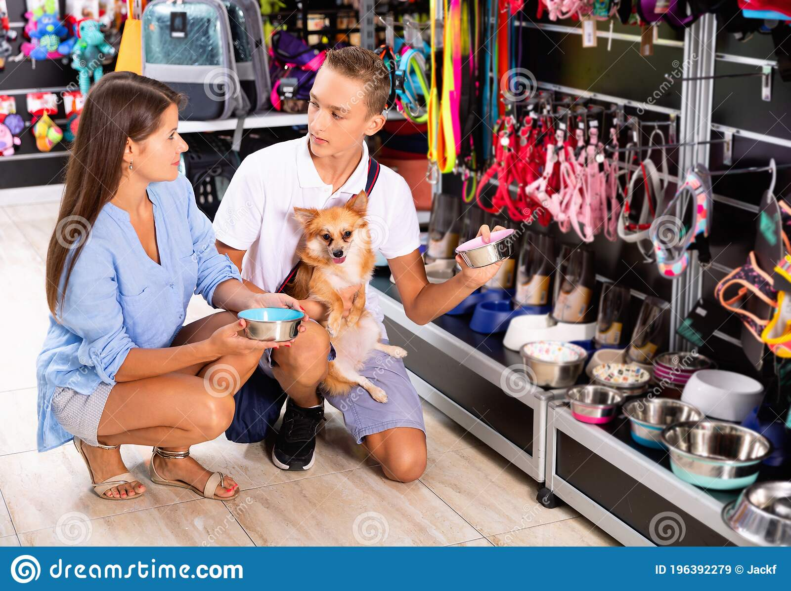 Cheerful Young Woman With Teenage Son And Cute Puppy Buying Dog Accessories In Store Stock Image Image Of Indoors Retail 196392279