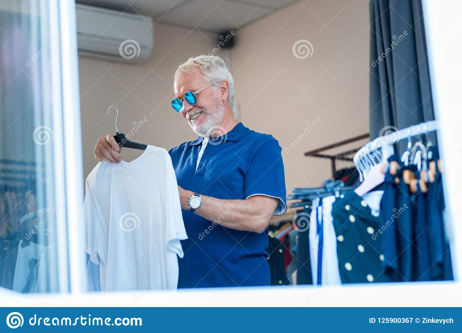 Cheerful Grey Haired Man Being Satisfied With Shopping Stock Image