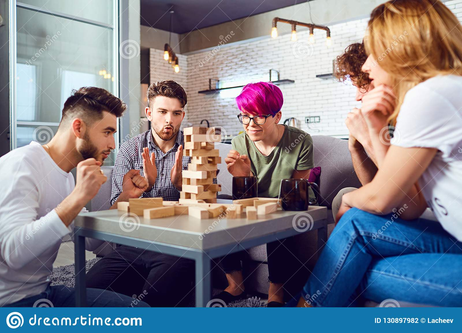 A Cheerful Group Of Friends Play Board Games. Stock Photo ...