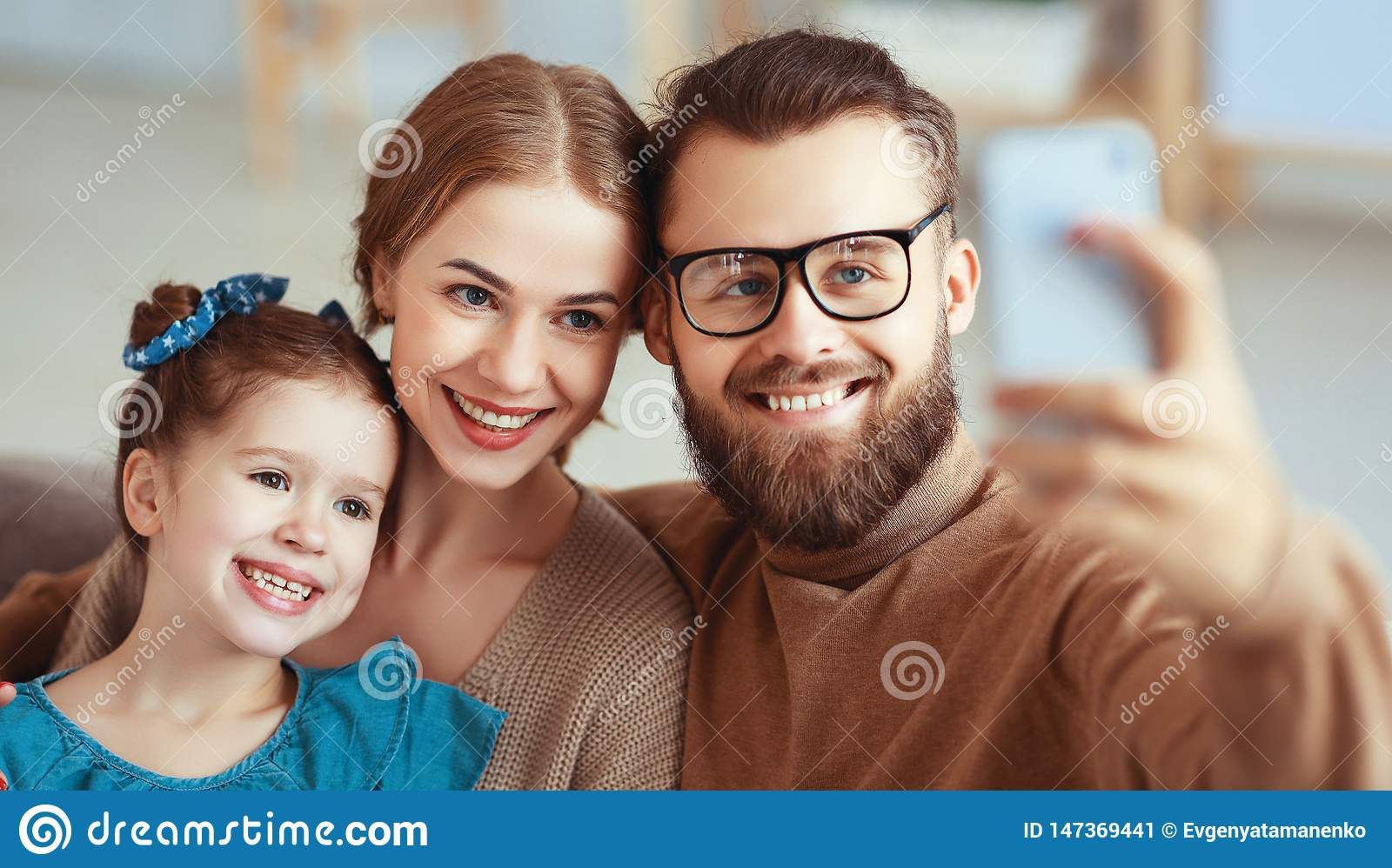 Cheerful happy family mother father and child take selfies, take pictures