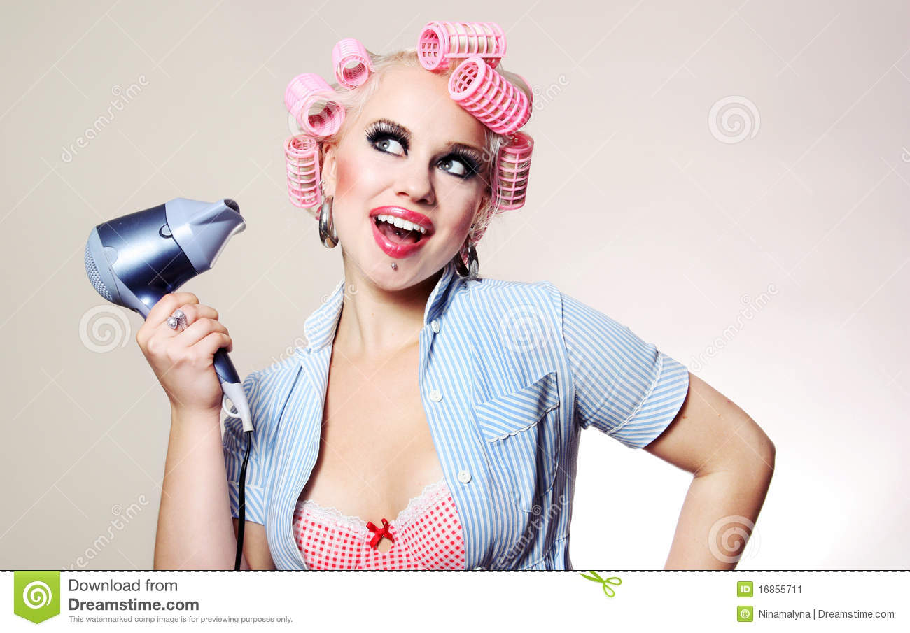 Cheerful housewife with hairdryer