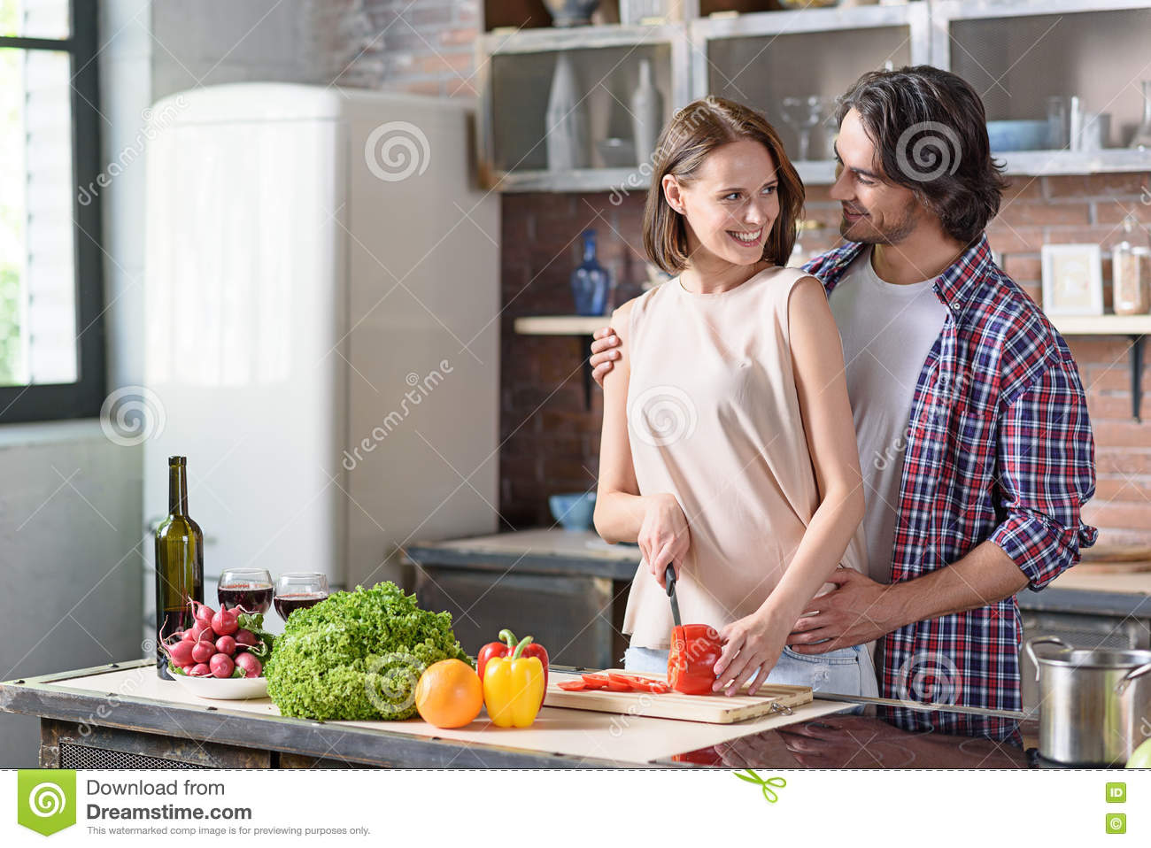 Cheerful Husband And Wife Preparing Romantic Dinner Stock Image