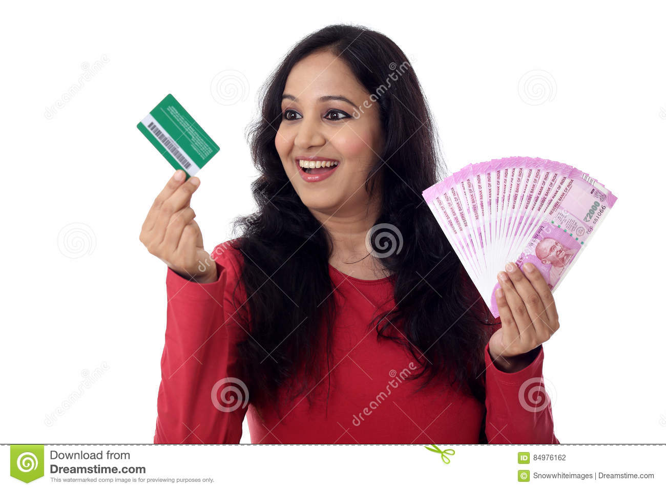 Cheerful indian woman holding a bunch of indian rupee and credit cheerful indian woman holding a bunch of indian rupee and credit card cashless purchase concept reheart Images