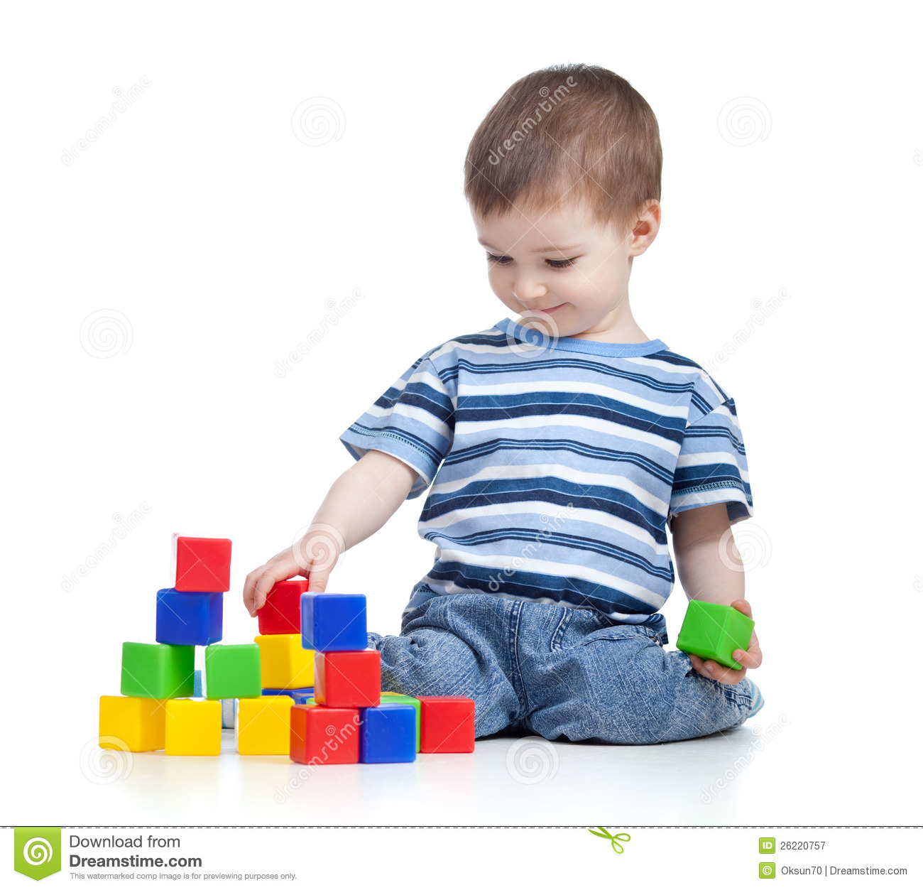 Cheerful kid boy with construction set