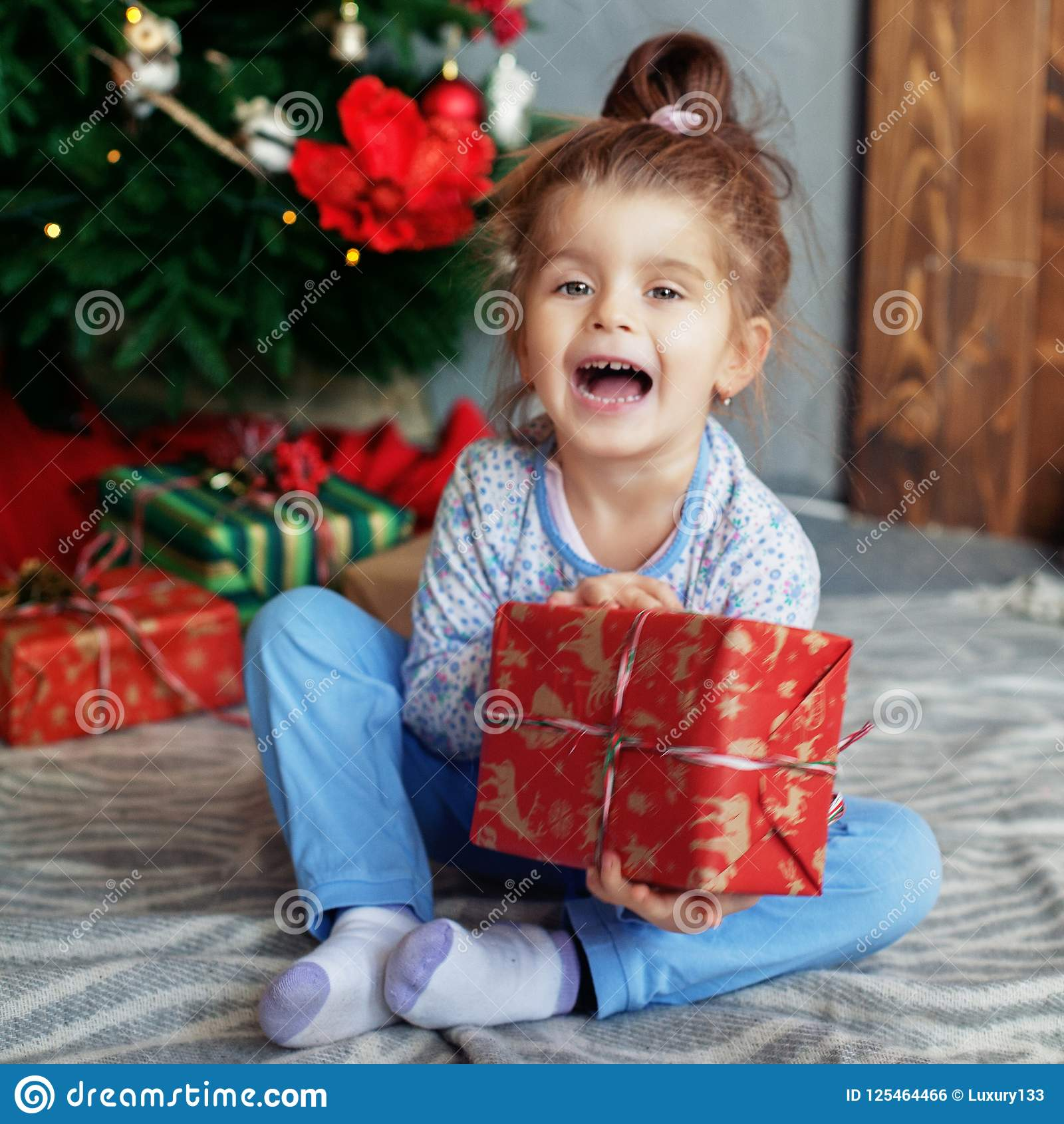 Cheerful Kid Opening Gifts. The Concept Of Christmas And New Year ...