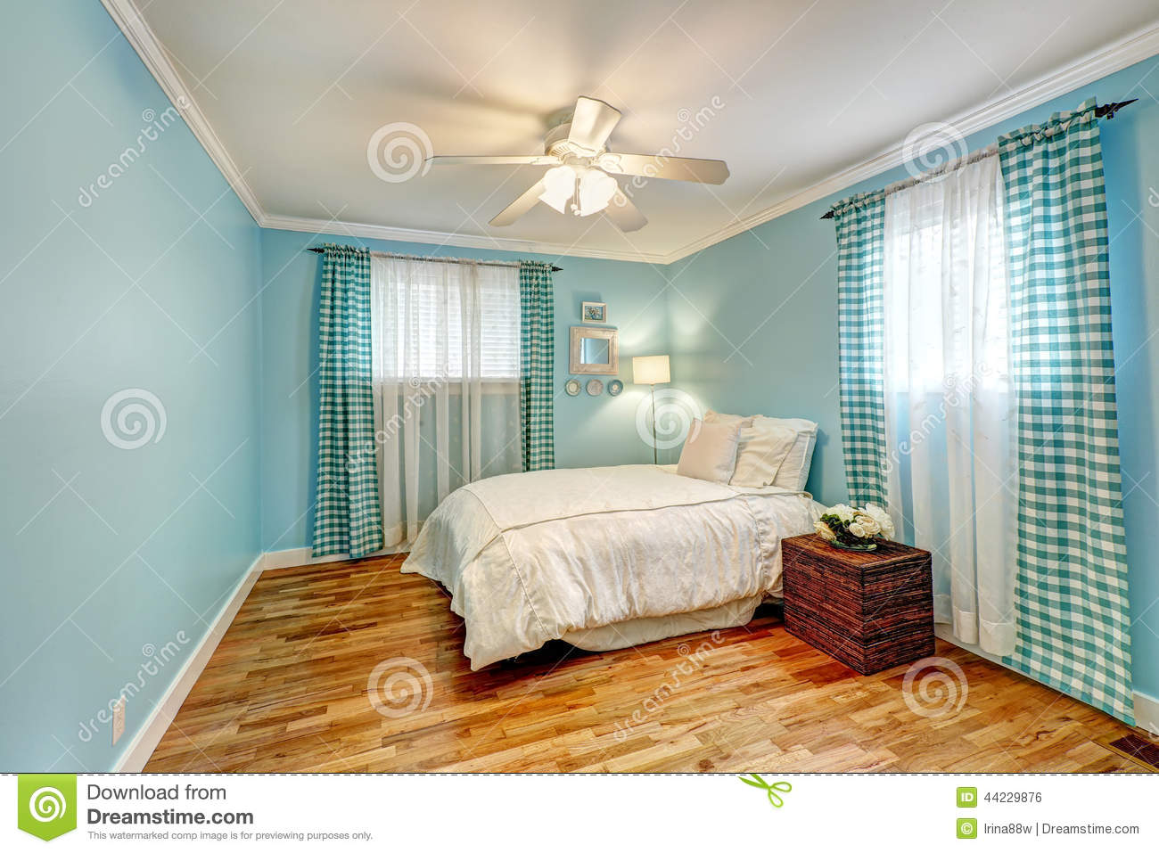 cheerful light blue bedroom with turquoise curtains and white bedding