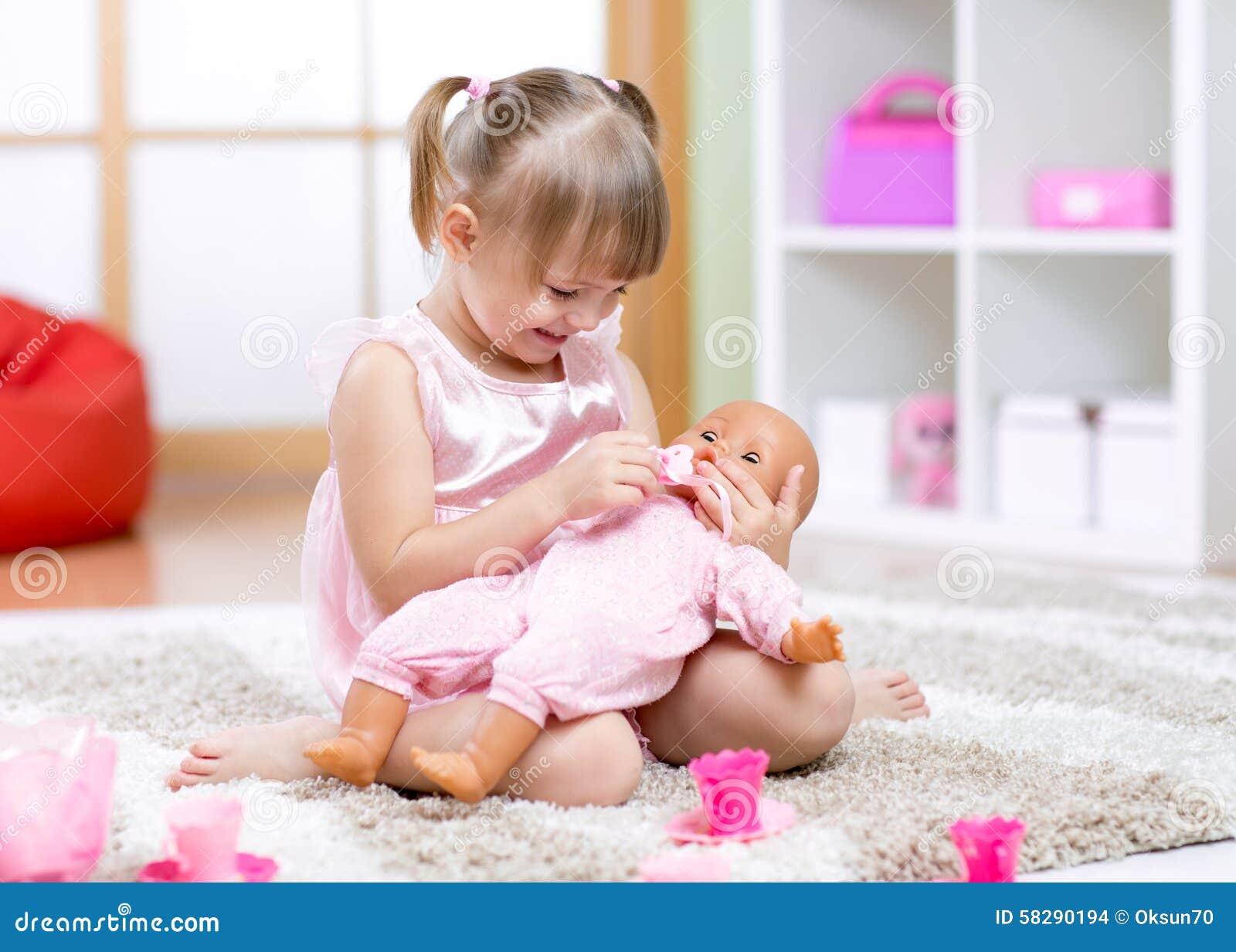 Cheerful little girl play in preschool
