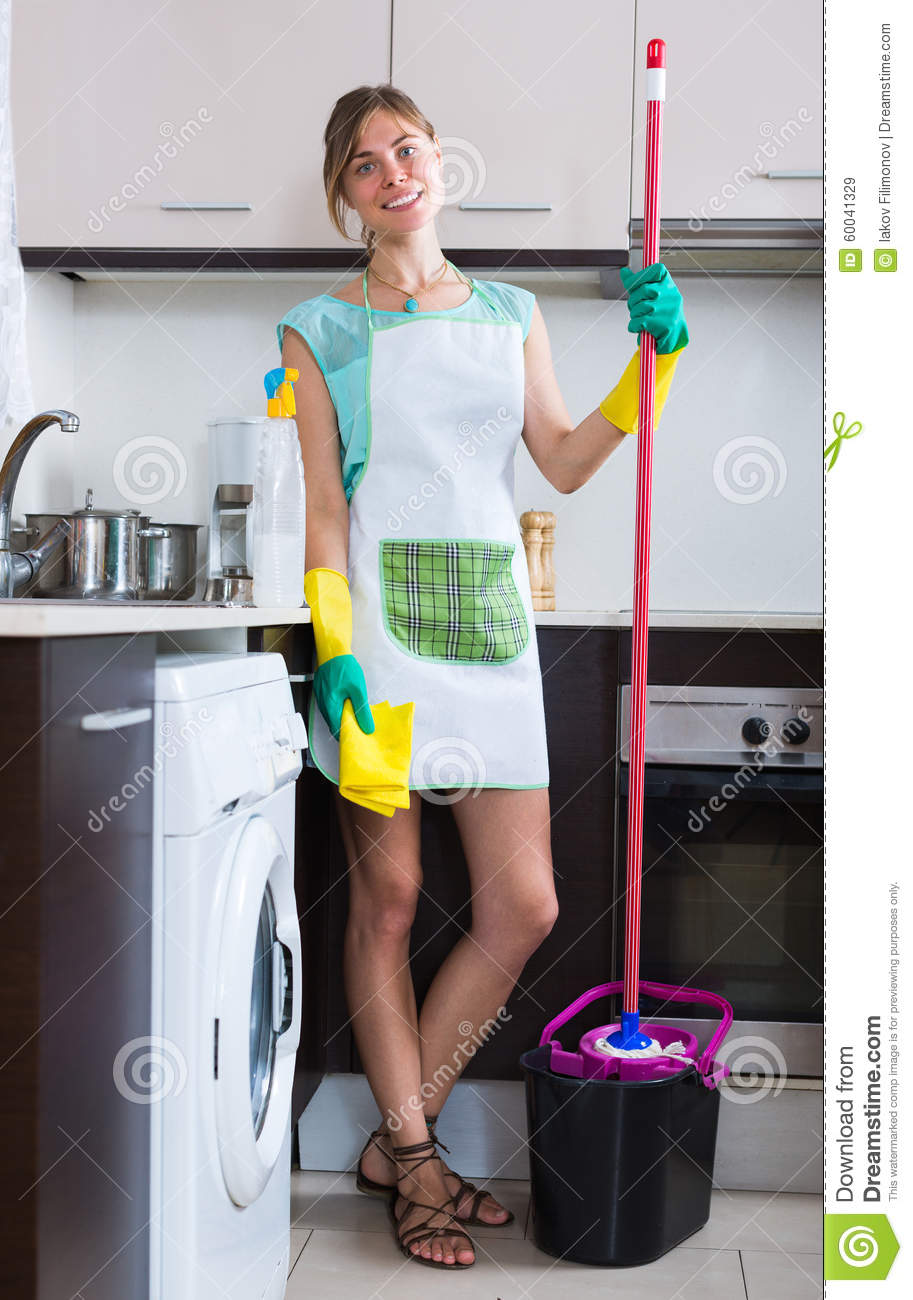 cheerful maid cleaning at kitchen stock photo - image
