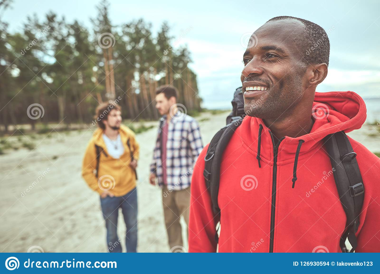 Cheerful man enjoying his journey with friends