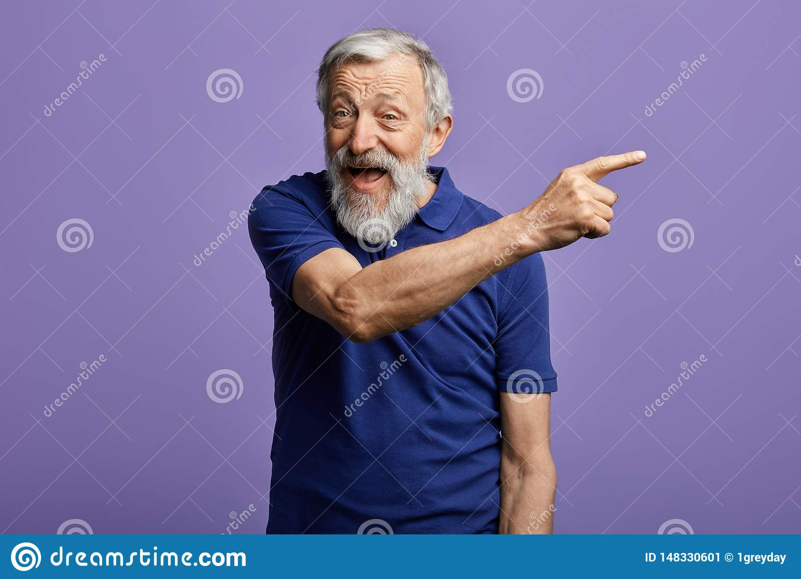 Cheerful man pointing at copy space