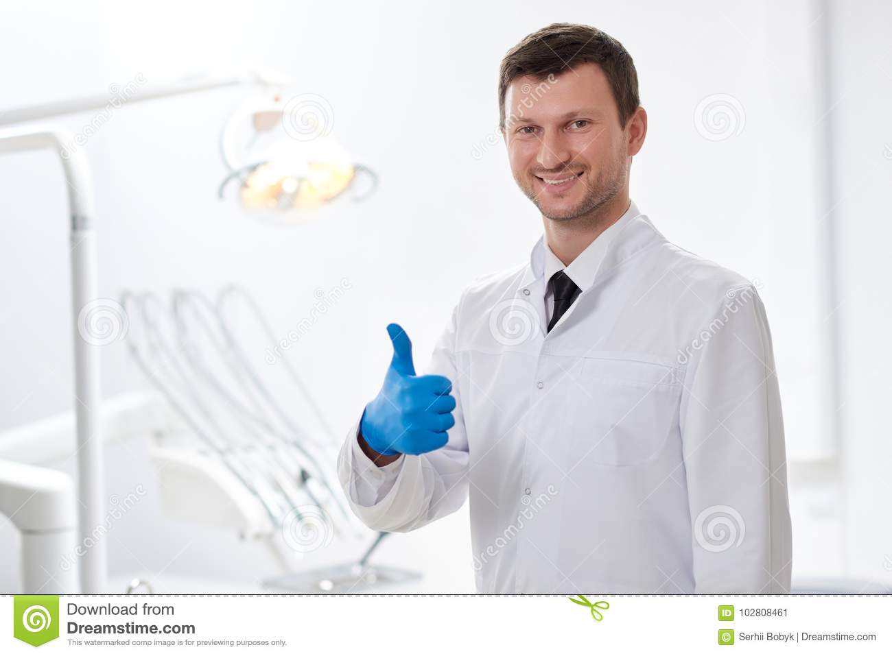 Professional Dentist At His Clinic Stock Image - Image of