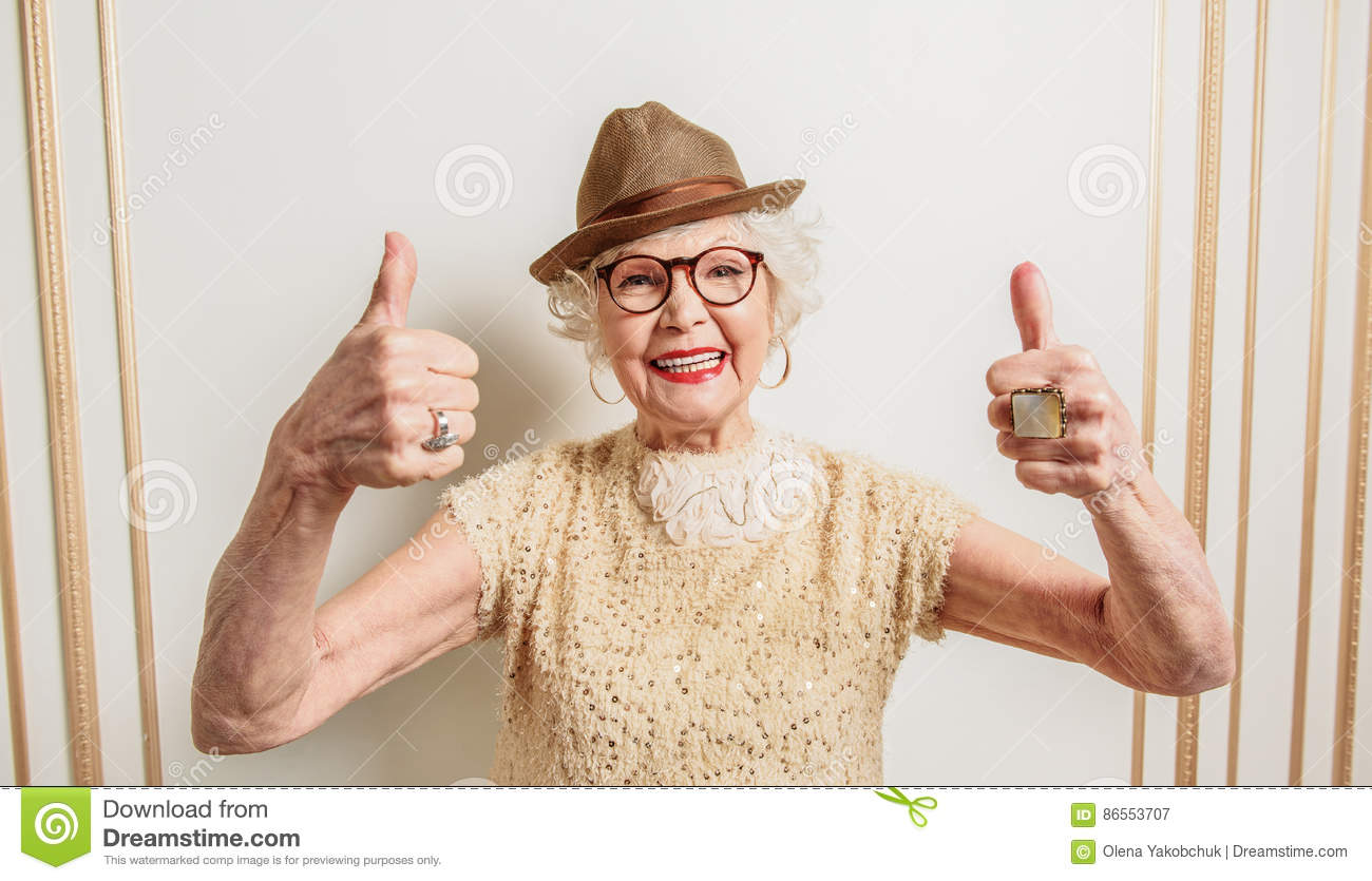 cheerful old lady showing okay sign stock image - image of casual