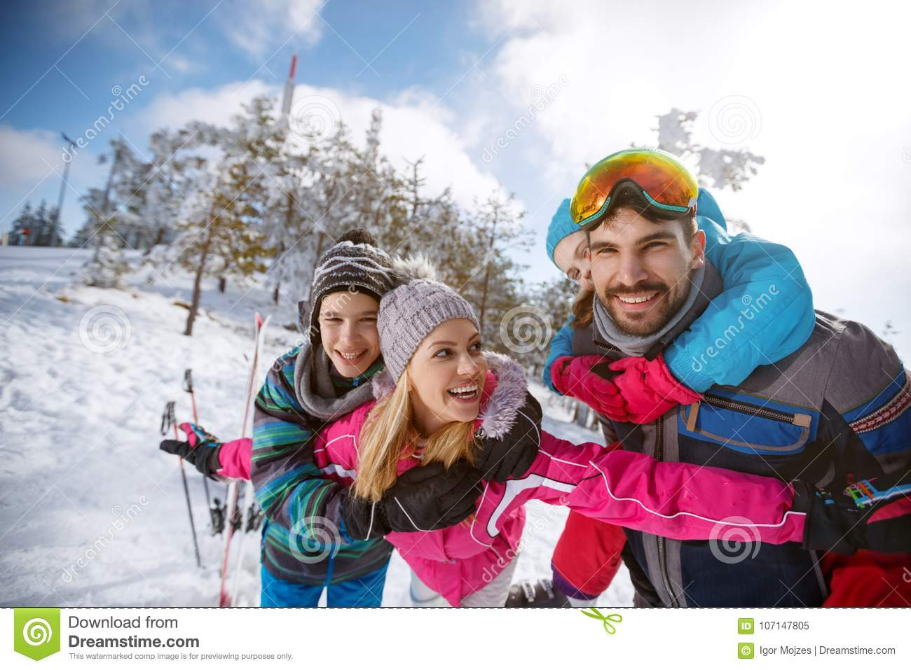 Cheerful parents with children happy together