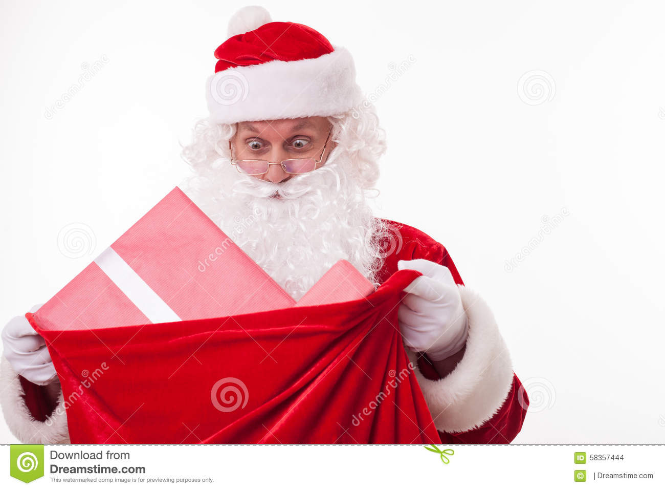 Cheerful Santa Claus Is Carrying A Bag Of Presents Stock