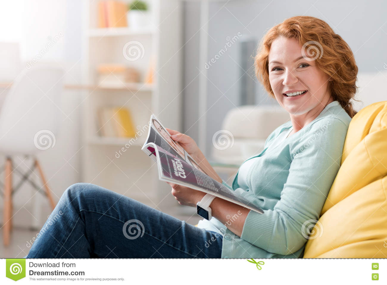 cheerful senior woman sitting on the couch stock photo image 75059487. Black Bedroom Furniture Sets. Home Design Ideas