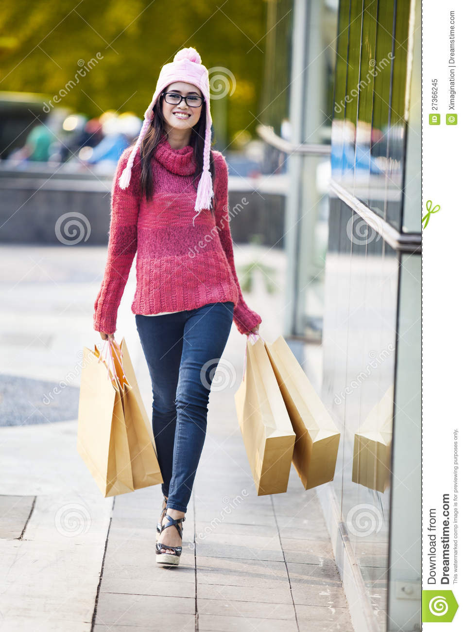 Cheerful shopper with brown shopping bags