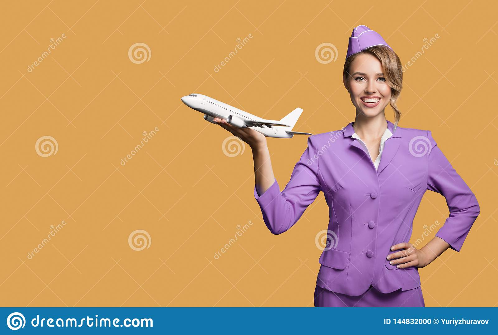 stewardess holding airplane in hand