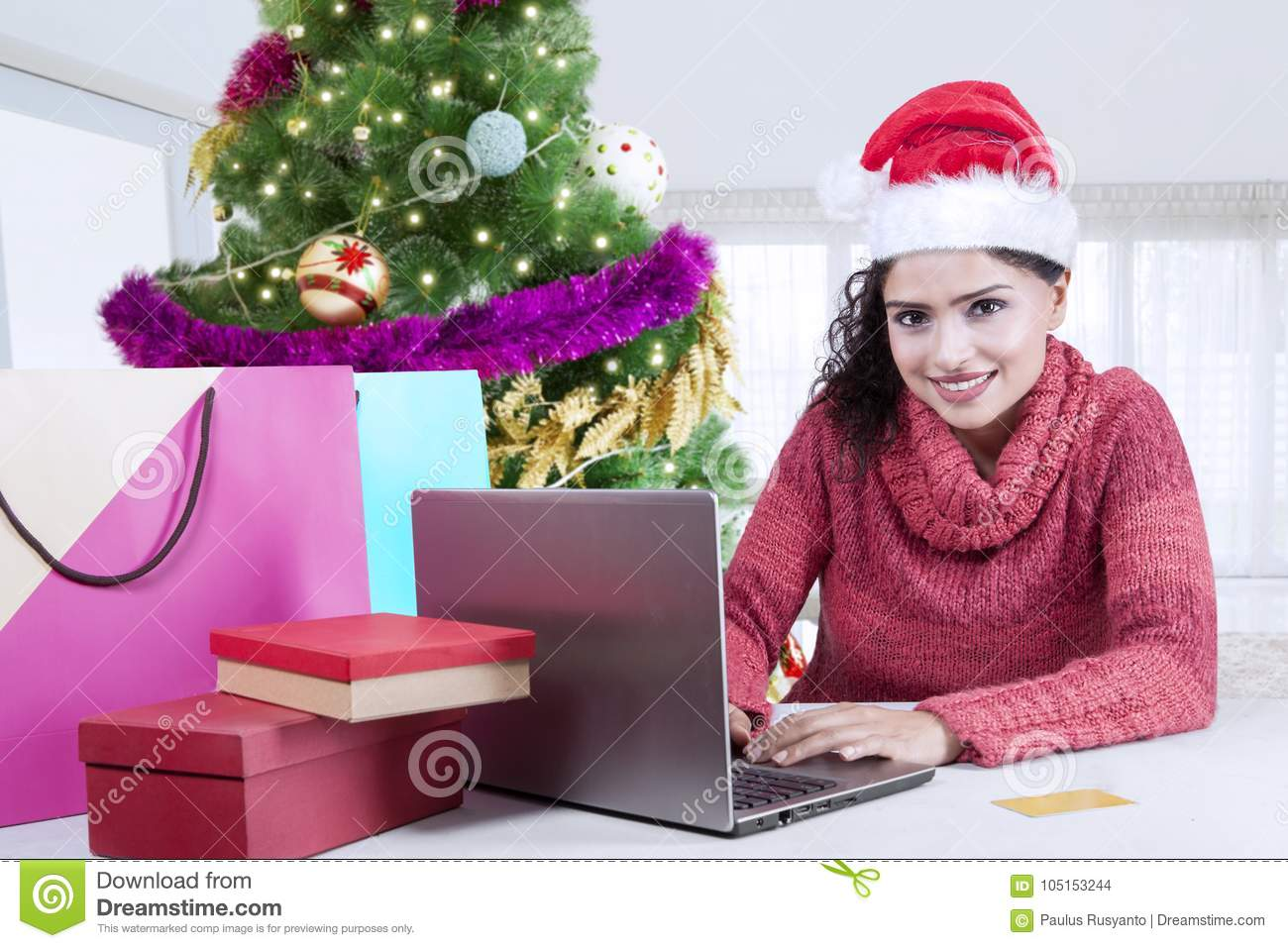 Cheerful Woman Buying Christmas Gifts Online Stock Photo - Image of ...