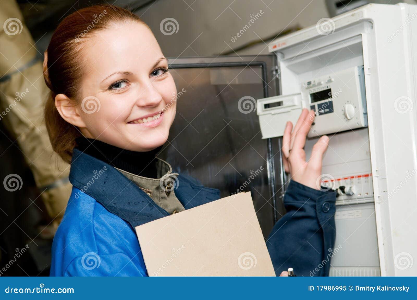 Plumber Teaching Apprentice To Fix Kitchen Sink Stock