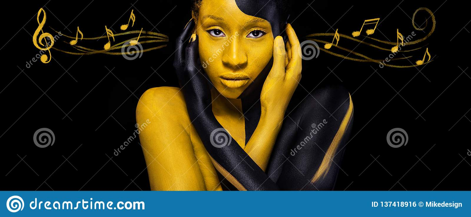 Cheerful young african woman with art fashion makeup. Amazing woman with black and yellow makeup and notes. Colorful