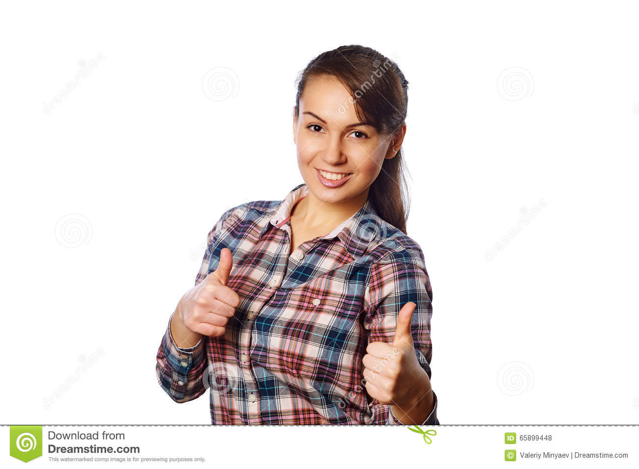 Cheerful young girl in checkered shirt showing thumbs up with both hands over white background