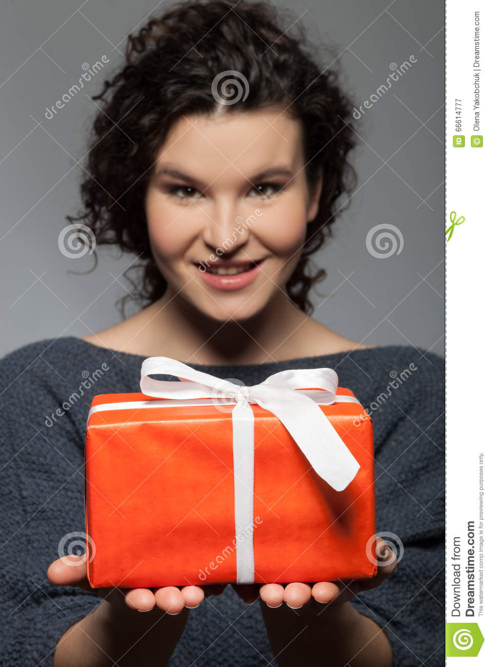 Cheerful young girl is preparing <b>pretty gift</b> - cheerful-young-girl-preparing-pretty-gift-i-have-present-you-portrait-cute-woman-holding-box-giving-to-66614777