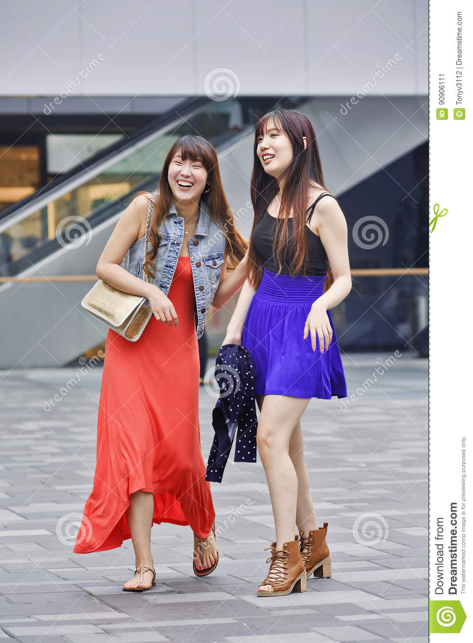 Cheerful young girls in a shopping area, Shanghai, China