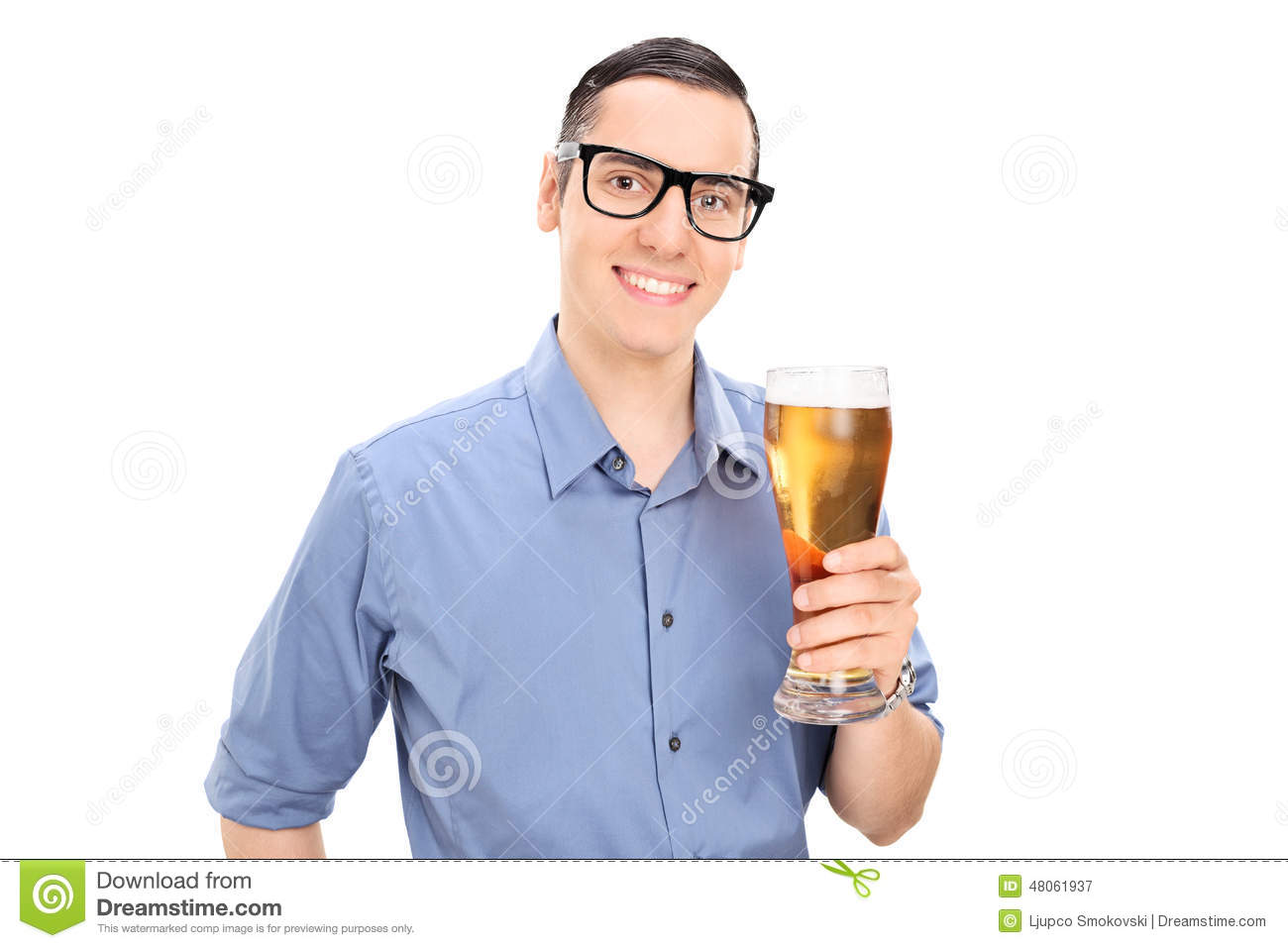 Cheerful Young Guy Holding A Pint Of Beer Stock Photo