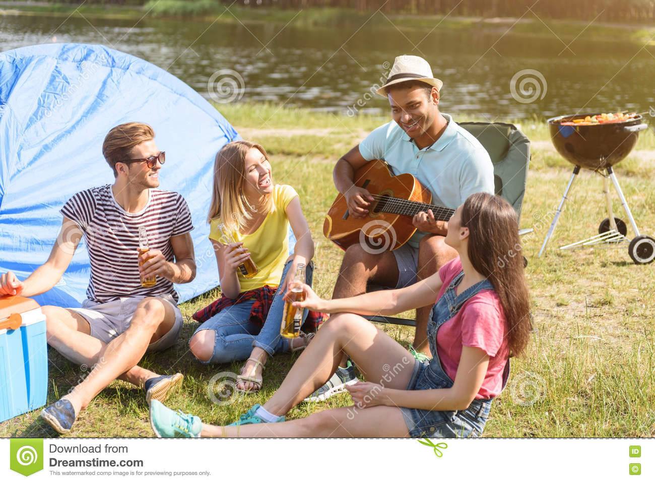 Cheerful young people making fun in nature stock photo for Cheerful nature