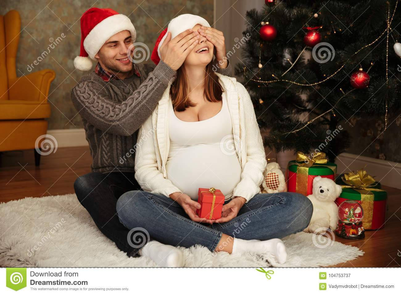 cheerful young pregnant woman with her husband