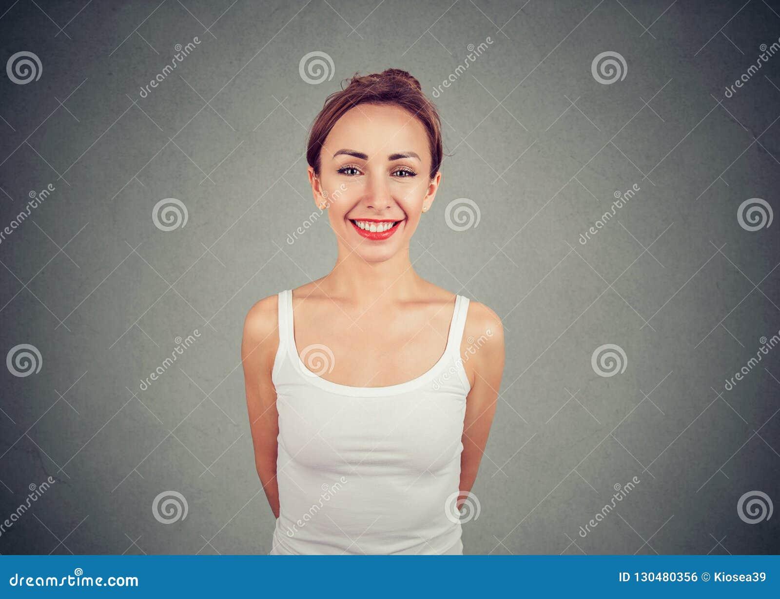 Cheerful young slim woman looking at camera