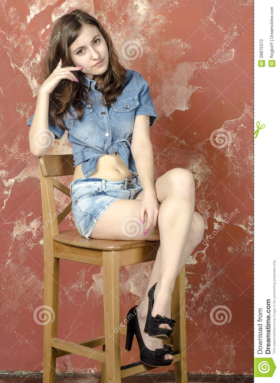 Cheerful Young Teen Girl In Denim Shorts Stock Photo - Image: 58875372