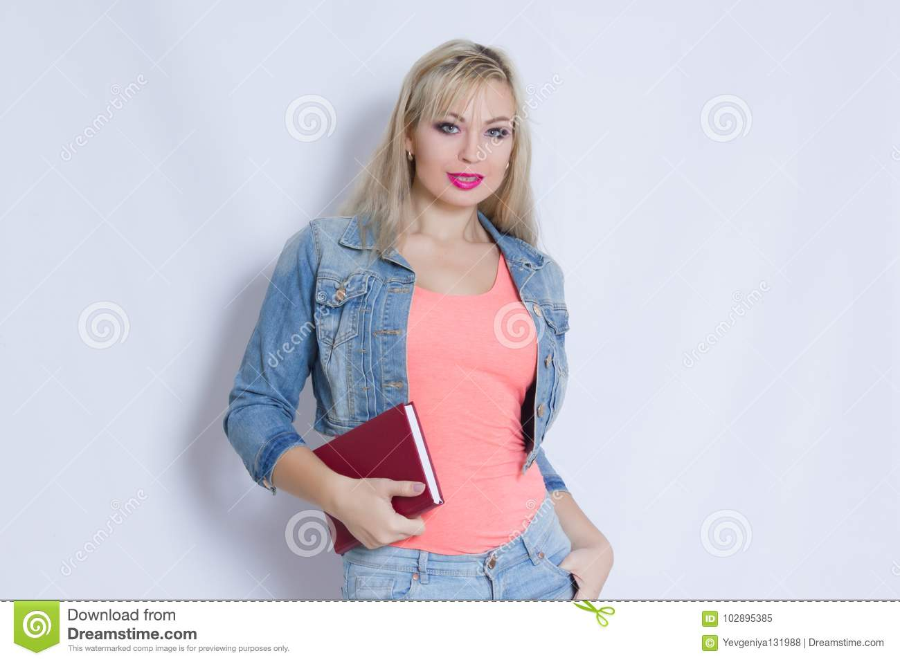 64c5c84f3c0a10 Beautiful Blond Young Woman In Pink Tank Top And Jeans Costume Stock ...