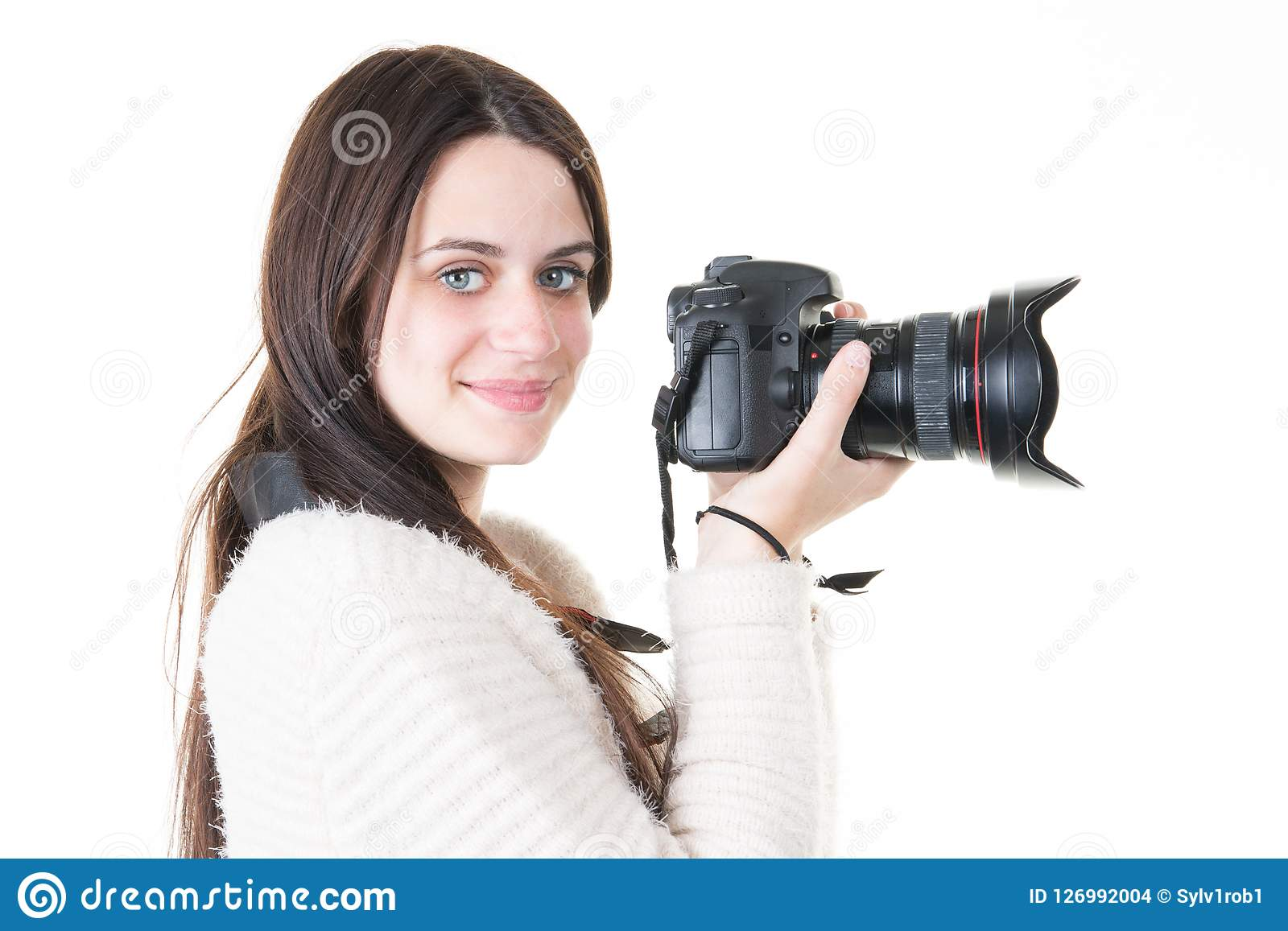 young woman photographer takes images with dslr camera