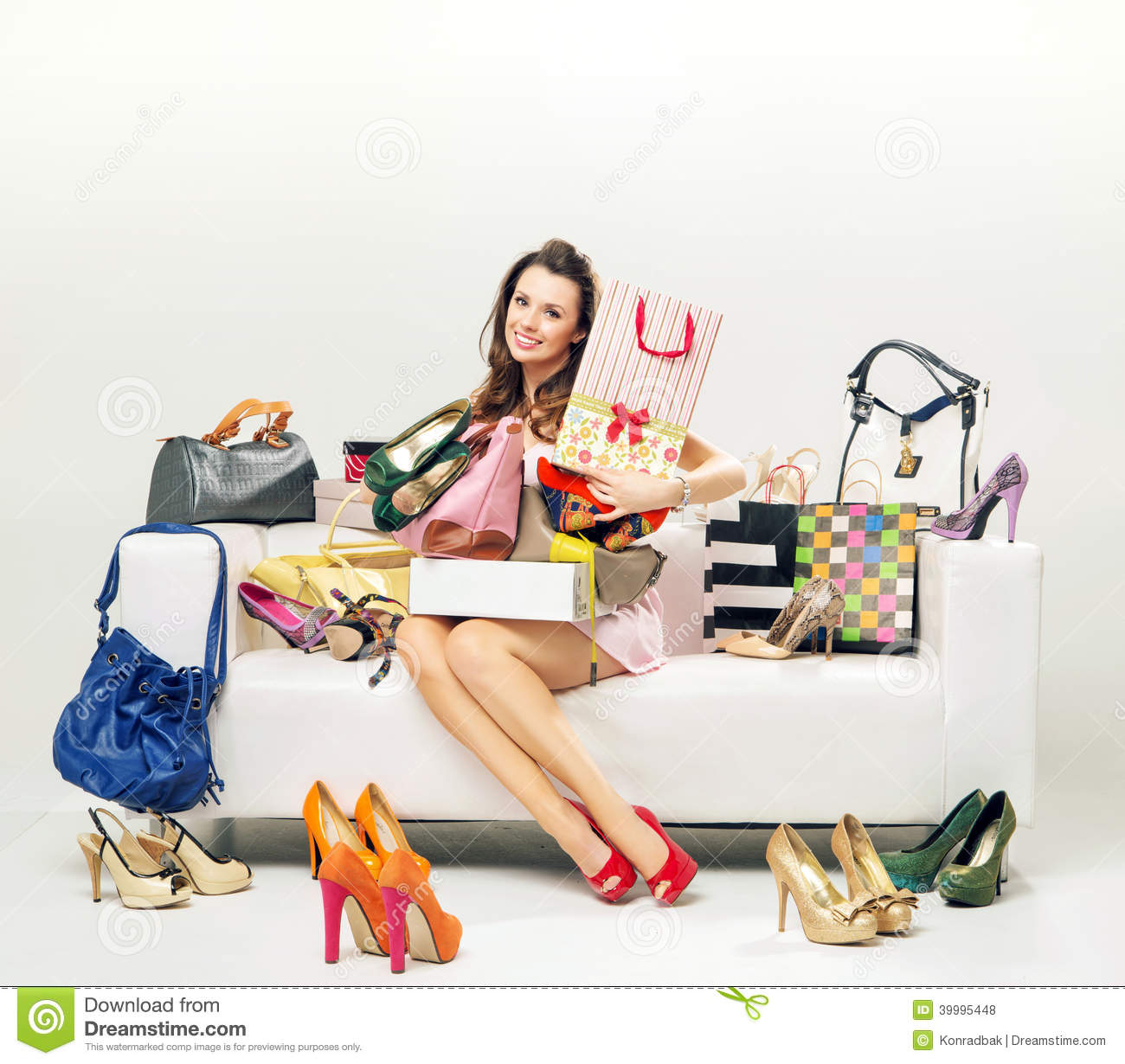 Cheerful young woman with plenty of shopping bags