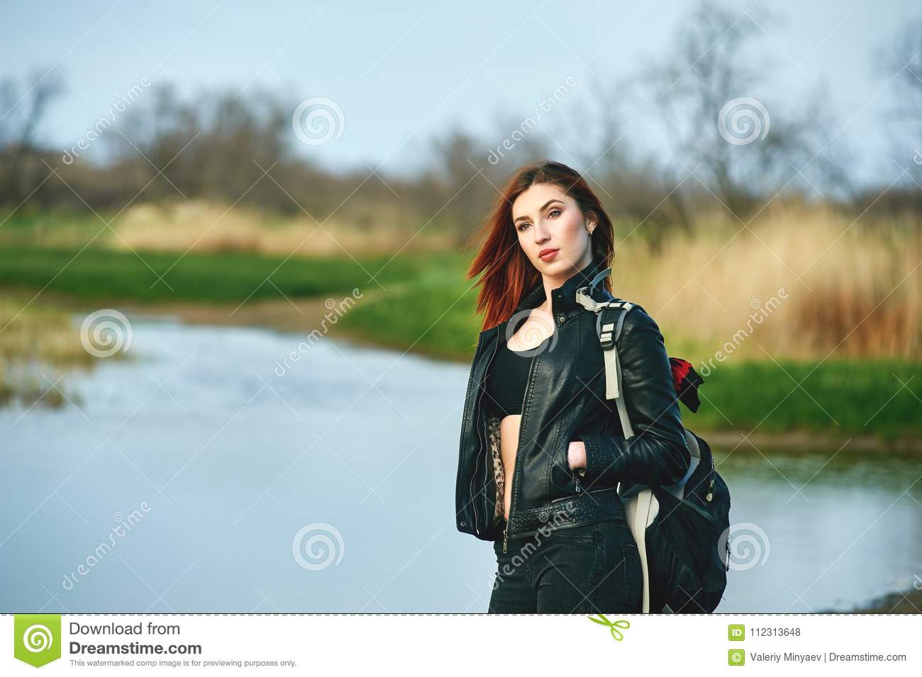 Cheerful young woman on spring walk