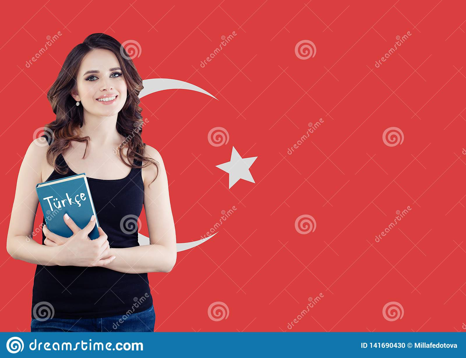 Cheerful young woman student with the Turkey flag. Learn turkish language, language school concept